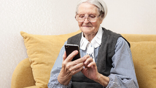 Photo of elderly woman with cell phone