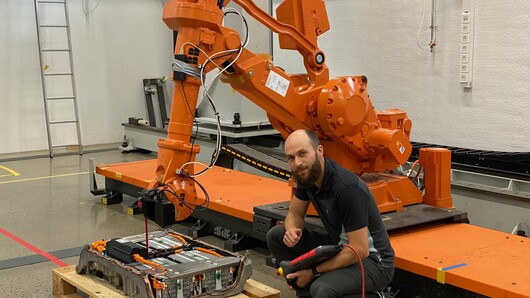 Martin Choux with a robot-machine, photo
